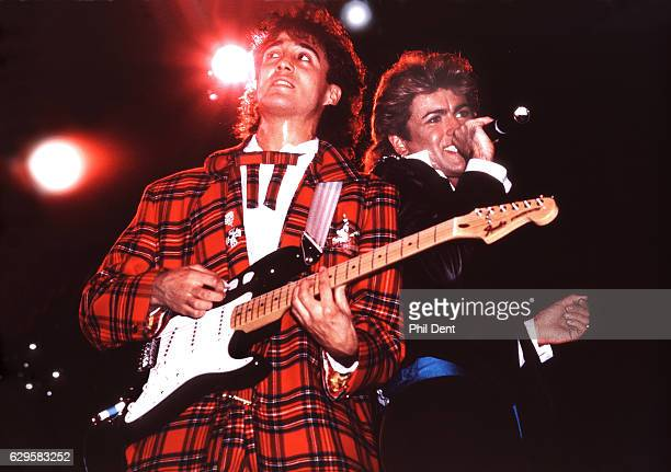 Andrew Ridgeley and George Michael of Wham perform on stage in London 1984