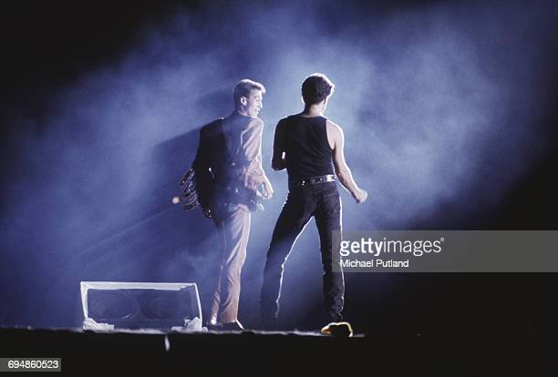 Andrew Ridgeley and George Michael of Wham perform together on stage at their farewell concert entitled 'The Final' at Wembley Stadium in London on...