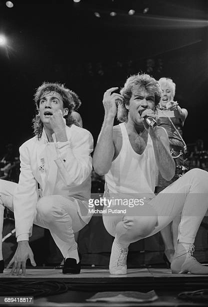 Andrew Ridgeley and George Michael of Wham performing during the pop duo's 1985 world tour January 1985 In the background is backing singer Shirlie...