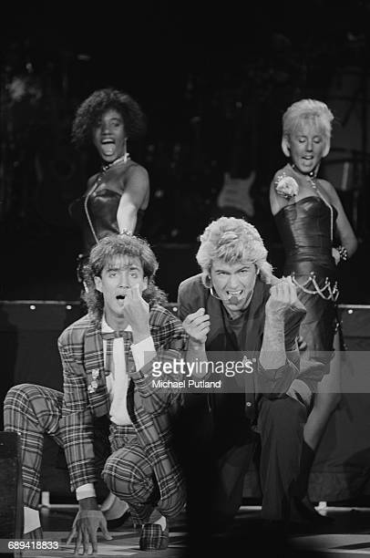 Andrew Ridgeley and George Michael of Wham performing during the pop duo's 1985 world tour January 1985 In the background are backing singers Pepsi...