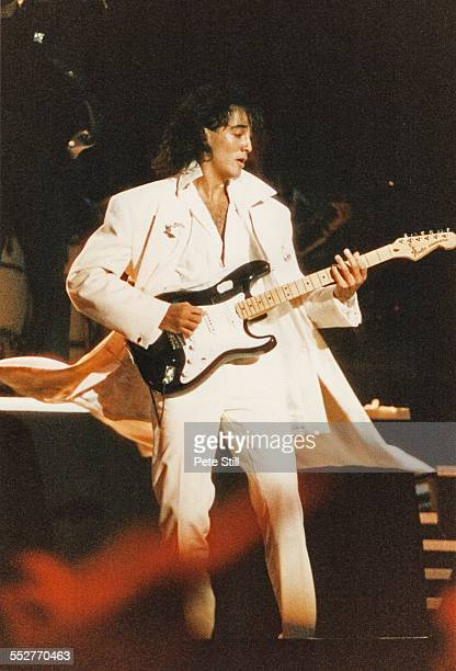 Andrew Ridgeley of Wham performs on stage at the National Exhibition Centre on February 27th 1985 in Birmingham England