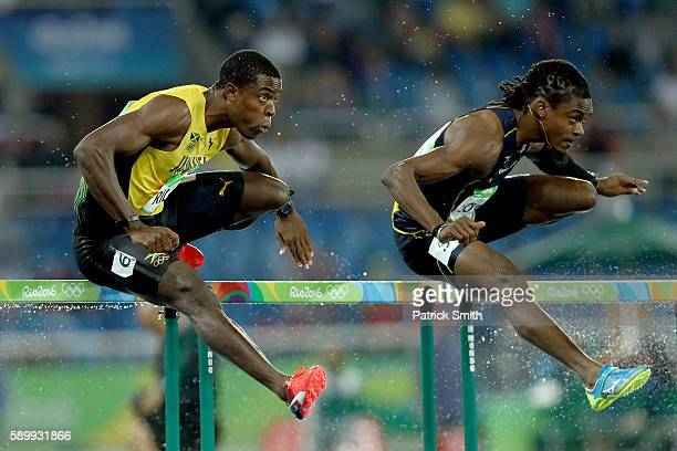 Andrew Riley of Jamaica and Eddie Lovett of Virgin Islands compete during the Men's 110m Hurdles Round 1 Heat 3 on Day 10 of the Rio 2016 Olympic...