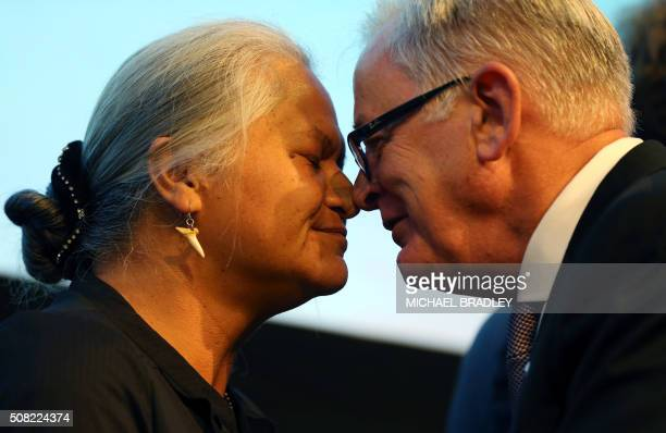 Andrew Robb the Minister for Trade and Investment from Australia is welcomed by a local Maori elder with a Hongi as Ministerial Representatives from...