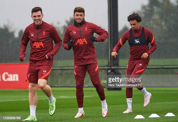 Andrew Robertson, Alex Oxlade-Chamberlain and Trent Alexander-Arnold of Liverpool during a training session at AXA Training Centre on October 18,...