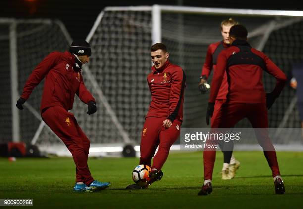 Andrew Robertson and Adam Lallana of Liverpool during a training session at Melwood Training Ground on January 3 2018 in Liverpool England