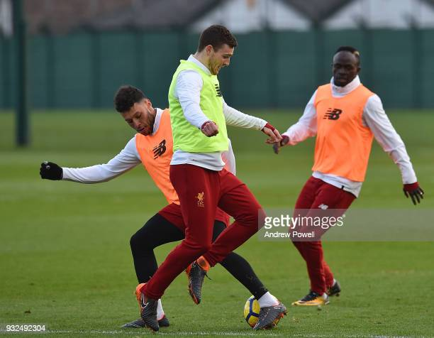 Andrew Robertson and Alex OxladeChamberlain of Liverpool during the training session at Melwood Training Ground on March 15 2018 in Liverpool England