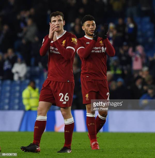 Andrew Robertson and Alex OxladeChamberlain of Liverpool show their appreciation to the fans at the end of the Premier League match between Brighton...
