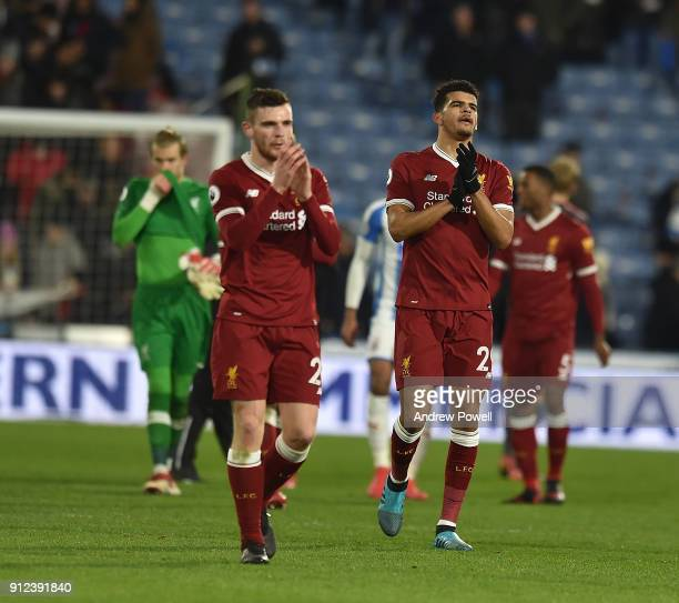 Andrew Robertson and Dominic Solanke of Liverpool showing their appreciation to the fans at the end of the Premier League match between Huddersfield...