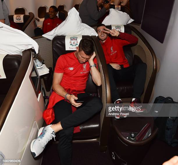 Andrew Robertson and James Milner of Liverpool on the plane ready to depart from Manchester Airport for Preseason tour in America on July 20 2018 in...