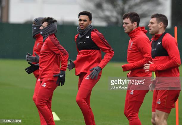 Andrew Robertson and James Milner of Liverpool with Trent AlexanderArnold during a training session at Melwood Training Ground on November 27 2018 in...