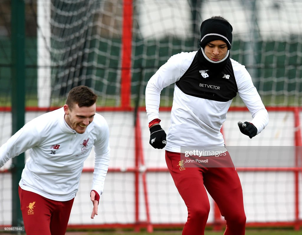 Andrew Robertson and Virgil van Dijk of Liverpool during a training session at Melwood Training Ground on March 1, 2018 in Liverpool, England.