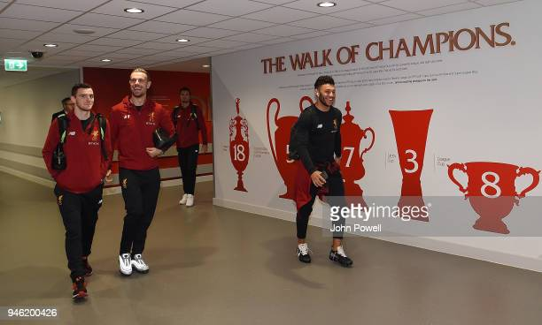 Andrew Robertson Jordan Henderson and Alex OxladeChamberlain of Liverpool arrives before the Premier League match between Liverpool and AFC...