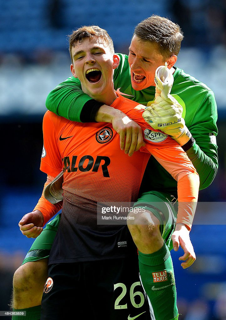 Andrew Robertson of Dundee United celebrates with team-mate Radoslaw Cierzniak as Dundee United win the William Hill Scottish Cup Semi Final between Rangers and Dundee United at Ibrox Stadium on April 12, 2014 in Glasgow, Scotland.