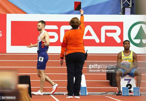 Andrew Robertson of Great Britain reacts as he is disqualified for a false start during the Men's 60 metres final on day two of the 2017 European...