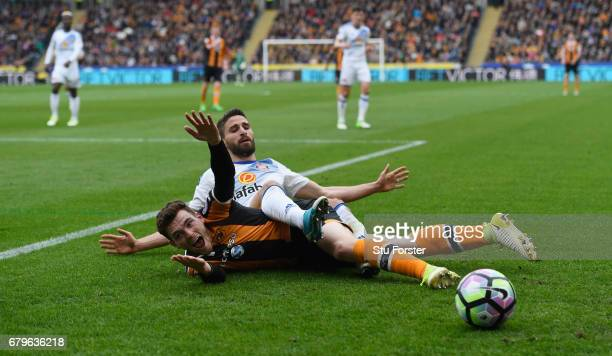 Andrew Robertson of Hull City and Fabio Borini of Sunderland compete for the ball during the Premier League match between Hull City and Sunderland at...