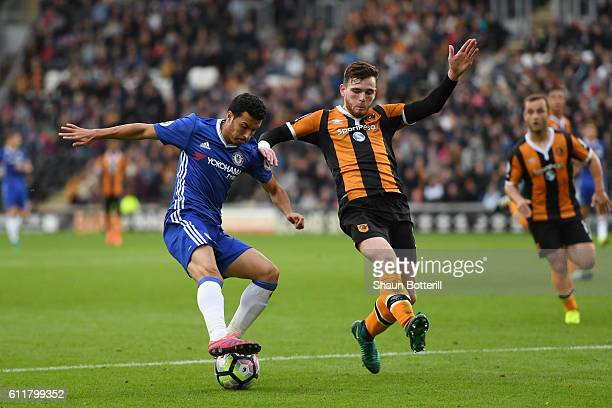 Andrew Robertson of Hull City attempts to block Pedro of Chelsea shot during the Premier League match between Hull City and Chelsea at KCOM Stadium...