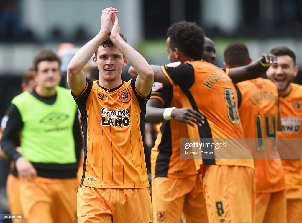Andrew Robertson of Hull City celebrates victory with team mates after the Sky Bet Championship Play Off semi final first leg match between Derby County and Hull City at the iPro Stadium on May 14, 2016 in Derby, England.