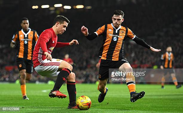 Andrew Robertson of Hull City closes down Ander Herrera of Manchester United during the EFL Cup SemiFinal First Leg match between Manchester United...