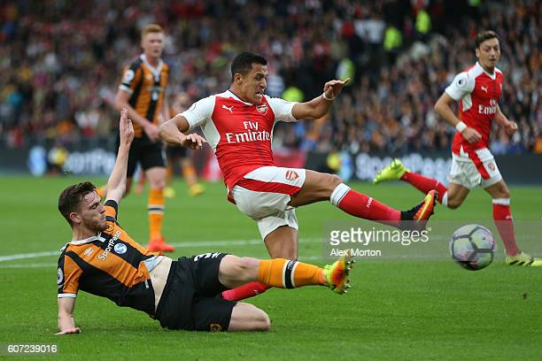Andrew Robertson of Hull City tackles Alexis Sanchez of Arsenal during the Premier League match between Hull City and Arsenal at KCOM Stadium on...