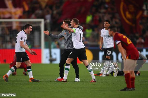 Andrew Robertson of Liverpool Adam Lallana of Liverpool and Jordan Henderson of Liverpool celebrate at full time during the UEFA Champions League...