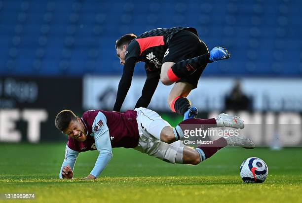 Andrew Robertson of Liverpool battles for possession with Johann Gudmundsson of Burnley during the Premier League match between Burnley and Liverpool...