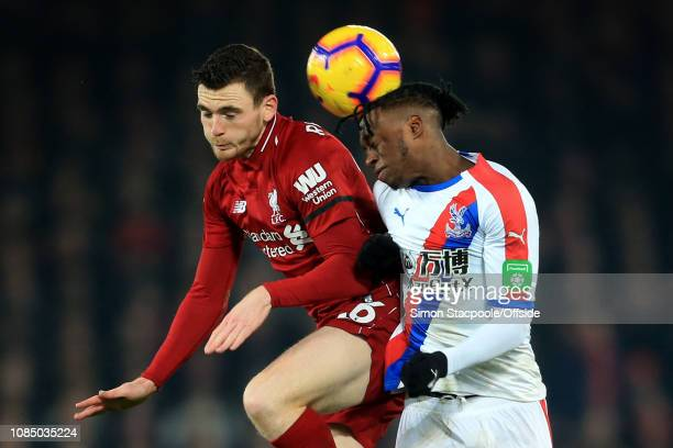 Andrew Robertson of Liverpool battles with Aaron WanBissaka of Palace during the Premier League match between Liverpool and Crystal Palace at Anfield...