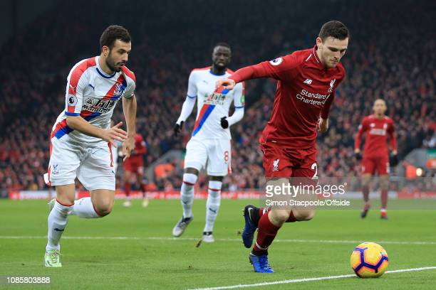 Andrew Robertson of Liverpool battles with Luka Milivojevic of Palace during the Premier League match between Liverpool and Crystal Palace at Anfield...