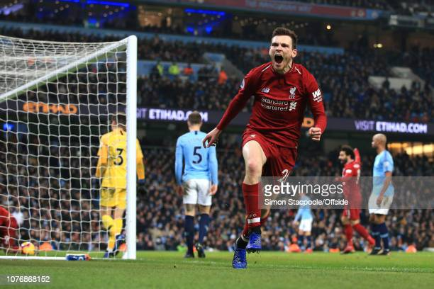 Andrew Robertson of Liverpool celebrates after making an assist for their equalising goal during the Premier League match between Manchester City and...