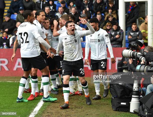 Andrew Robertson of Liverpool celebrates after Mohamed Salah scored the final goal during the Premier League match between Crystal Palace and...