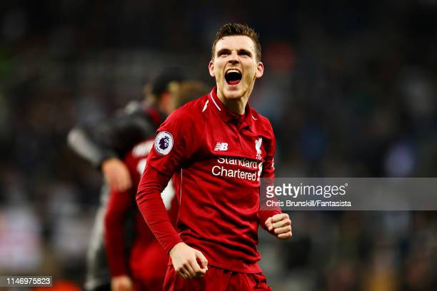 Andrew Robertson of Liverpool celebrates after the Premier League match between Newcastle United and Liverpool FC at St James Park on May 04 2019 in...
