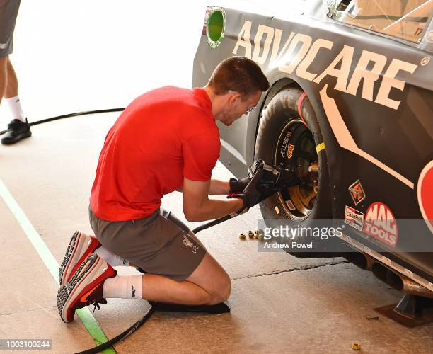 Andrew Robertson of Liverpool changing tyres during a tour of Roush Fenway Racing on July 21 2018 in Charlotte North Carolina