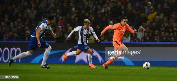 Andrew Robertson of Liverpool competes with Otavio of FC Porto during the UEFA Champions League Round of 16 First Leg match between FC Porto and...