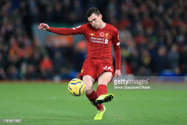 Andrew Robertson of Liverpool crosses the ball to set up and assist for their 2nd goal during the Premier League match between Liverpool FC and...