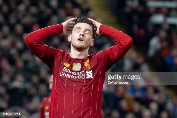 Andrew Robertson of Liverpool FC looks dejected during the UEFA Champions League round of 16 second leg match between Liverpool FC and Atletico...