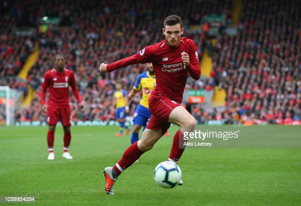 Andrew Robertson of Liverpool FC runs with the ball during the Premier League match between Liverpool FC and Southampton FC at Anfield on September...