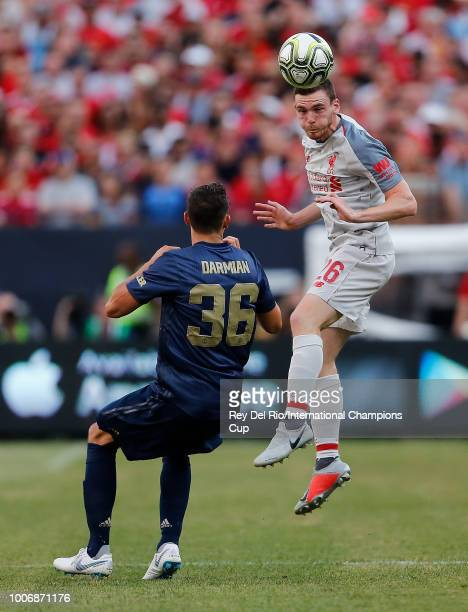 Andrew Robertson of Liverpool heads the ball in front of Matteo Darmian of Manchester United in the second half during the International Champions...