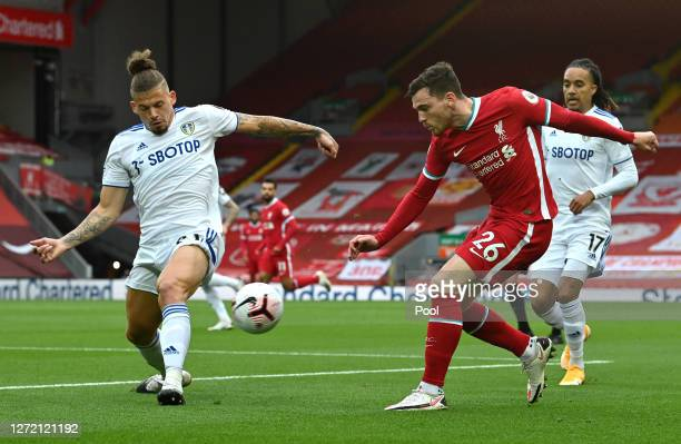 Andrew Robertson of Liverpool is challenged by Kalvin Phillips of Leeds United during the Premier League match between Liverpool and Leeds United at...