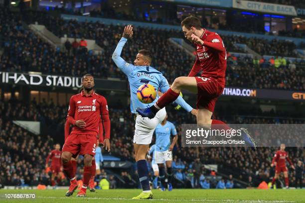 Andrew Robertson of Liverpool makes a cross that leads to their equalising goal during the Premier League match between Manchester City and Liverpool...
