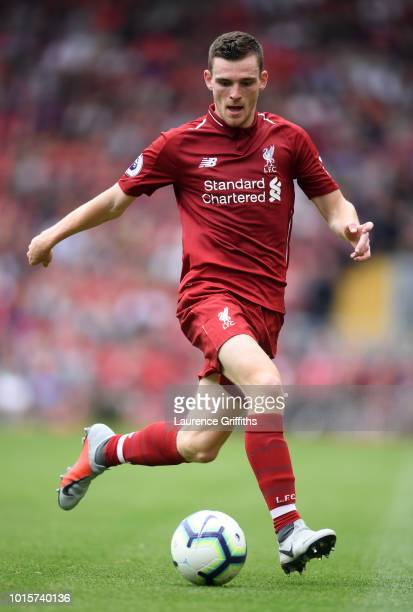 Andrew Robertson of Liverpool runs with the ball during the Premier League match between Liverpool FC and West Ham United at Anfield on August 12...