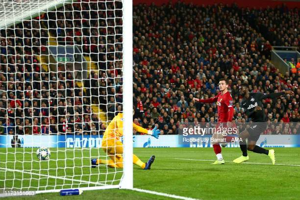 Andrew Robertson of Liverpool scores a goal to make it 20 during the UEFA Champions League group E match between Liverpool FC and RB Salzburg at...