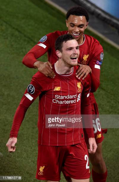 Andrew Robertson of Liverpool scores the second goal and celebrates during the UEFA Champions League group E match between Liverpool FC and RB...