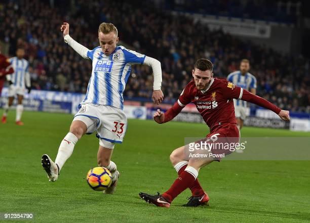 Andrew Robertson of Liverpool with Florent Hadergjonaj of Huddersfield during the Premier League match between Huddersfield Town and Liverpool at...