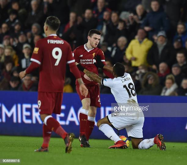 Andrew Robertson of Liverpool with Jordan Ayew of Swansea during the Premier League match between Swansea City and Liverpool at Liberty Stadium on...