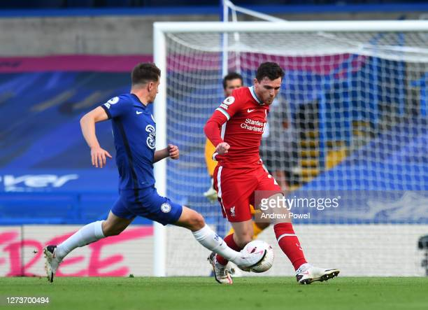 Andrew Robertson of Liverpool with Mason Mount of Chelsea during the Premier League match between Chelsea and Liverpool at Stamford Bridge on...