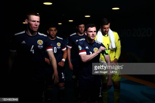 Andrew Robertson of Scotland adjusts his captains armband as he leads the team out for the second half during the UEFA Euro 2020 Championship Group D...