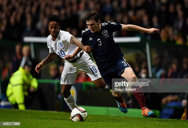 Andrew Robertson of Scotland goes past the challenge from Raheem Sterling of England during the International Friendly match between Scotland and...