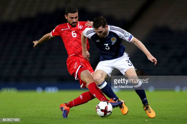 Andrew Robertson of Scotland is tackled by Ryan Fenech of Malta during the FIFA 2018 World Cup Qualifier between Scotland and Malta at Hampden Park...