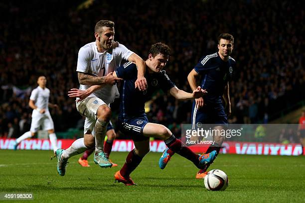 GLASGOW SCOTLAND NOVEMBER Andrew Robertson of Scotland shields the ball from Jack Wilshere of England during the International Friendly match between...