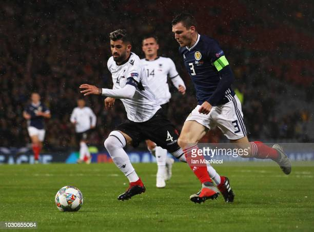 Andrew Robertson of Scotland takes on Elseid Hysaj of Albania during the UEFA Nations League C Group One match between Scotland and Albania at...