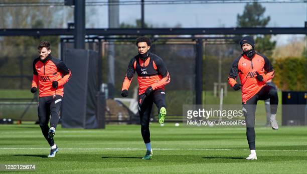 Andrew Robertson, Trent Alexander-Arnold and Alex Oxlade-Chamberlain of Liverpool during a training session ahead of the UEFA Champions League...